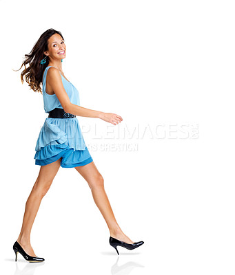 Buy stock photo Fashionable young woman in blue dress walking on white background - Copyspace