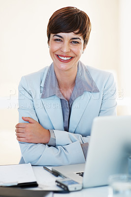 Buy stock photo Portrait of attractive business woman with laptop sitting at her desk