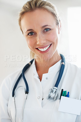 Buy stock photo Closeup of beautiful health professional smiling with colleague in background