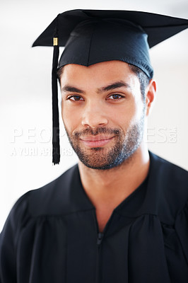 Buy stock photo Closeup portrait of confident man wearing graduation cap and gown