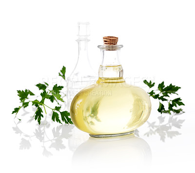 Buy stock photo Olive oil and parsley leaves on white background