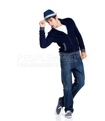 Buy stock photo Portrait of a handsome young male fashion model holding his hat, isolated on a white background