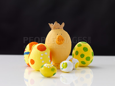 Buy stock photo Handmade easter eggs on white surface against black background
