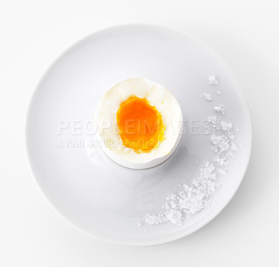 Buy stock photo Closeup of soft boiled egg in cup with salt isolated on white background