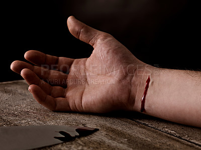 Buy stock photo Suicide attempt - Cut wrist and bloody knife on wooden table