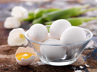 Buy stock photo Glass bowl full of raw eggs with a half cracked egg on dirty surface