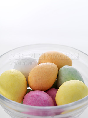 Buy stock photo Glass bowl full of easter chocolate eggs isolated on white background