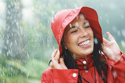 Buy stock photo Pretty woman holding raincoat hat on head