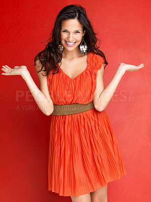 Buy stock photo Portrait of an attractive young woman with hands outstretched on red background