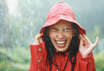 Buy stock photo Woman holding her hat to prevent from getting wet