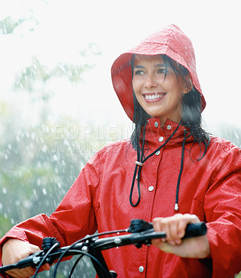 Buy stock photo Happy woman on bike in rain