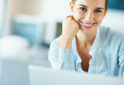 Buy stock photo Happy woman resting her face on her hand while in front of laptop