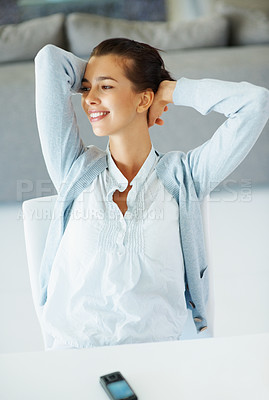Buy stock photo Woman sitting with hands clasped behind her, looking into distance