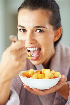Buy stock photo Pretty woman eating bowl of fruit