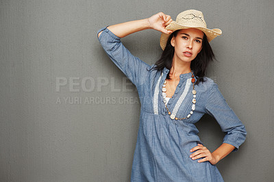 Buy stock photo Pretty woman giving seductive look while holding cowboy hat