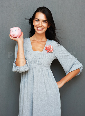 Buy stock photo Attractive woman holding piggy bank