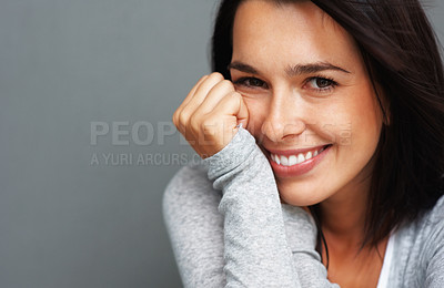 Buy stock photo Closeup of woman leaning with face on hand and smiling in a shy manner