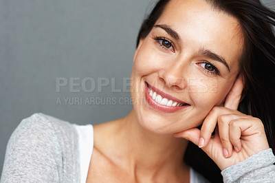 Buy stock photo Closeup of pretty woman resting her face on her hand and smiling
