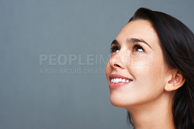 Buy stock photo Closeup of young woman looking up