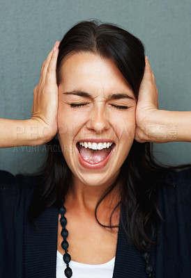 Buy stock photo Woman screaming while covering her ears and shutting eyes in frustration