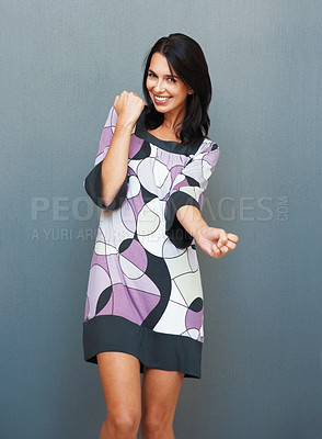 Buy stock photo Flirtatious woman dancing while smiling