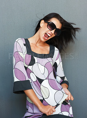 Buy stock photo Woman wearing sunglasses dancing with excitement