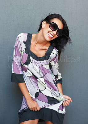 Buy stock photo Woman smiling and dancing with sunglasses on