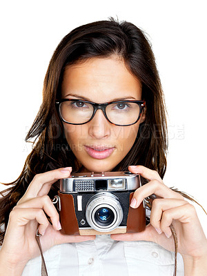 Buy stock photo An attractive young lady in glasses holding a camera on white background