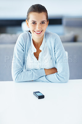 Buy stock photo Portrait of pretty woman with cell phone on desk