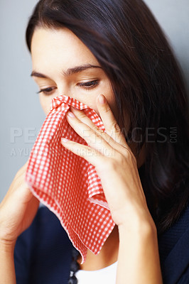 Buy stock photo Young sick girl with handkerchief wiping her nose
