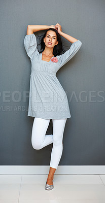 Buy stock photo Portrait of pretty woman leaning against wall with hands in hair