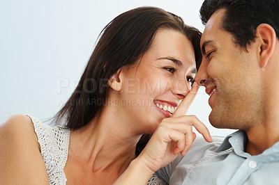 Buy stock photo Portrait of young naughty woman touching nose of man