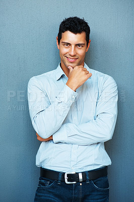 Buy stock photo Portrait of smart young man posing with hand on chin