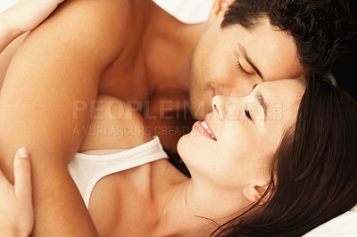 Buy stock photo Portrait of young couple cuddling in bed