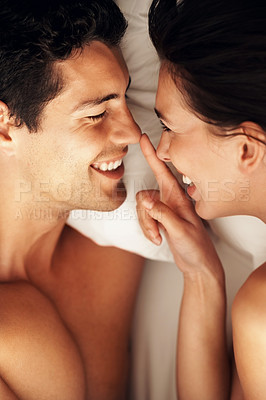 Buy stock photo Portrait of young couple having fun in bed