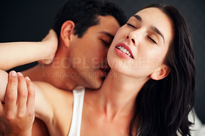 Buy stock photo Closeup of young man kissing his lover's neck