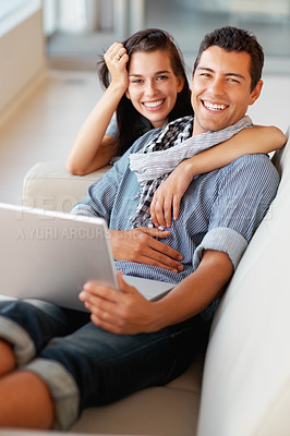 Buy stock photo Cheerful couple relaxing in living room and smiling