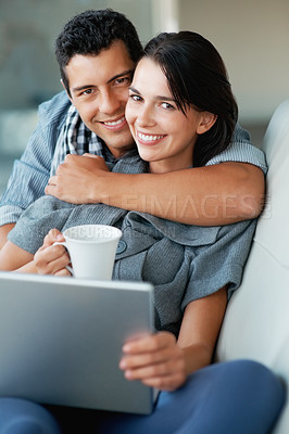 Buy stock photo Smiling woman with cup and laptop while man embracing her from behind