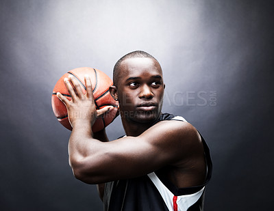 Buy stock photo Portrait of a confident young man playing basketball against grunge background