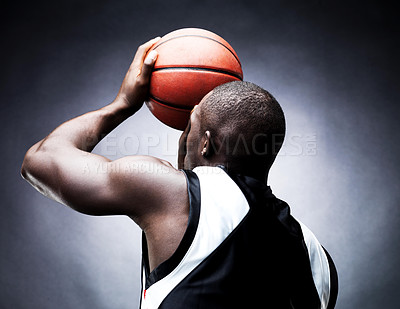 Buy stock photo Rear view of a young male basketball player in free throw pose against grunge background