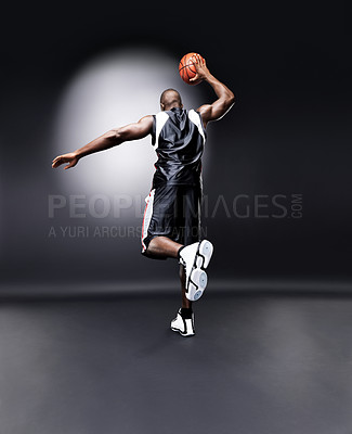 Buy stock photo Rear view of an afroamerican man playing basketball practicing against grunge background