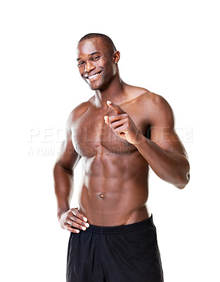 Buy stock photo Portrait of a fit young guy smiling and pointing at you against white background