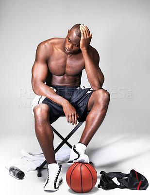 Buy stock photo Young african-american basketball player looking depressed after a defeat