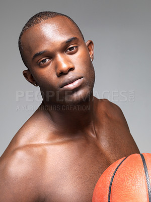 Buy stock photo Closeup portrait of a smart young african male with basketball