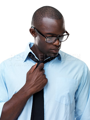 Buy stock photo Portrait of a young african american business man feeling uncomfortable against white background