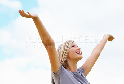 Buy stock photo Cheerful happy woman with arms raised looking at the sky