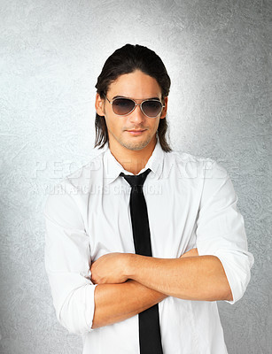 Buy stock photo Man wearing sunglasses and posing with arms folded