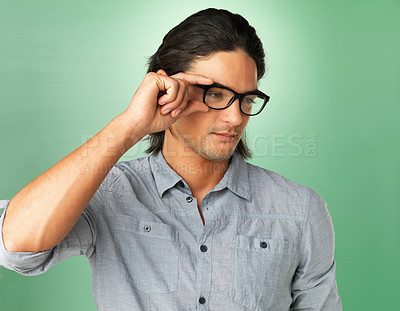 Buy stock photo Handsome man adjusting glasses on face