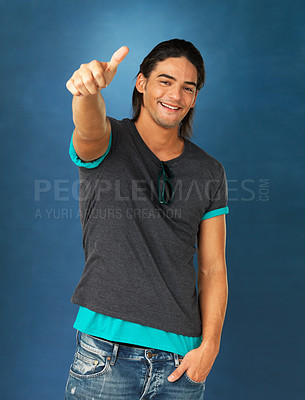 Buy stock photo Handsome man dressed casually giving thumbs up