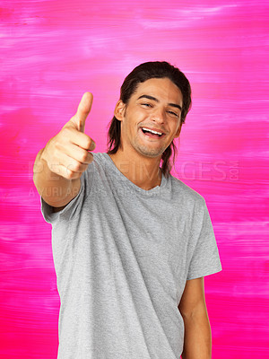 Buy stock photo Casually dressed man giving thumbs up against pink background